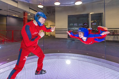 Indoor Skydiving instructor and child